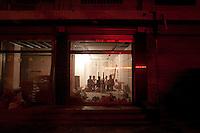 Men Sitting in a Suburban Building Development in Baodi, China.  © LAN