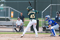 Oakland Athletics third baseman Max Schuemann (45) at bat in front of catcher Mario Trinci (6) during an exhibition game against Team Italy at Lew Wolff Training Complex on October 3, 2018 in Mesa, Arizona. (Zachary Lucy/Four Seam Images)