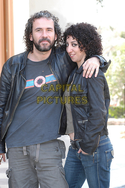 GUILLERMO TOLEDO & MONICA CERVERA.Photocall for film Crimen Ferpecto (2004).Rome, Italy, March 31st 2005..half length hugging arm around on shoulder.Ref: CAV.www.capitalpictures.com.sales@capitalpictures.com.©Luca Cavallari/Capital Pictures.