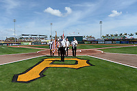 General view of the flag presentation before a Pittsburgh Pirates Spring Training game against the Boston Red Sox on March 12, 2015 at McKechnie Field in Bradenton, Florida.  Boston defeated Pittsburgh 5-1.  (Mike Janes/Four Seam Images)