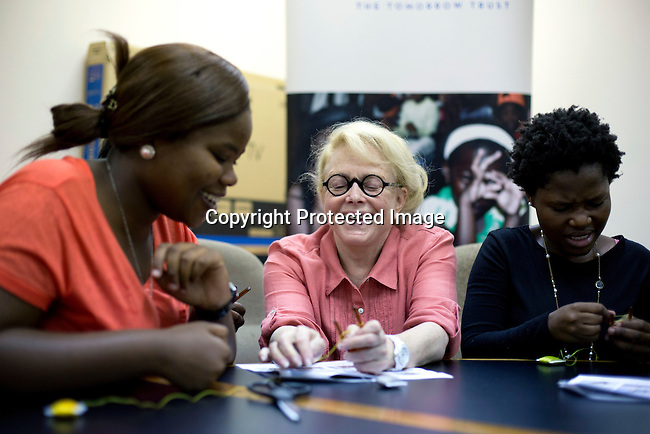 JOHANNESBURG, SOUTH AFRICA: Mary Fisher, an Aids activist, author and artist teaches women crafts during a workshop in Johannesburg, South Africa. Mary Fisher is infected with HIV-Aids and held a passionate speech at the Republican Convention in 1992 speaking about Aids.