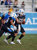Alaric Gonzalez (10) hands off to Jack Codwell (28) - Norland Vikings (Miami) vs IMG Academy Football on October 26, 2019 at IMG Academy in Bradenton, Florida.  (Mike Janes Photography)