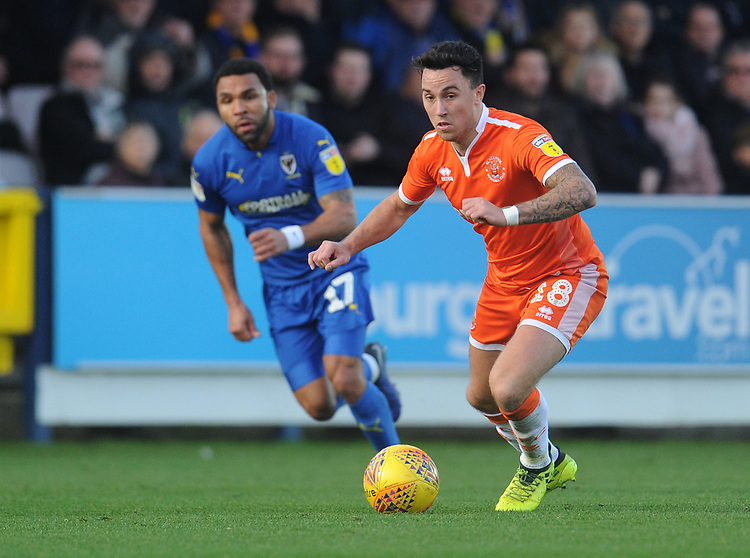 Blackpool's John O'Sullivan under pressure from AFC Wimbledon's Andy Barcham<br /> <br /> Photographer Kevin Barnes/CameraSport<br /> <br /> The EFL Sky Bet League One - AFC Wimbledon v Blackpool - Saturday 29th December 2018 - Kingsmeadow Stadium - London<br /> <br /> World Copyright © 2018 CameraSport. All rights reserved. 43 Linden Ave. Countesthorpe. Leicester. England. LE8 5PG - Tel: +44 (0) 116 277 4147 - admin@camerasport.com - www.camerasport.com