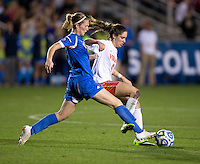 Jenna Richmond (7) of UCLA fights for the ball with Morgan Brian (6) of Virginia during the Women's College Cup semifinals at WakeMed Soccer Park in Cary, NC. UCLA advance on penalty kicks after typing Virginia, 1-1 in regulation time.