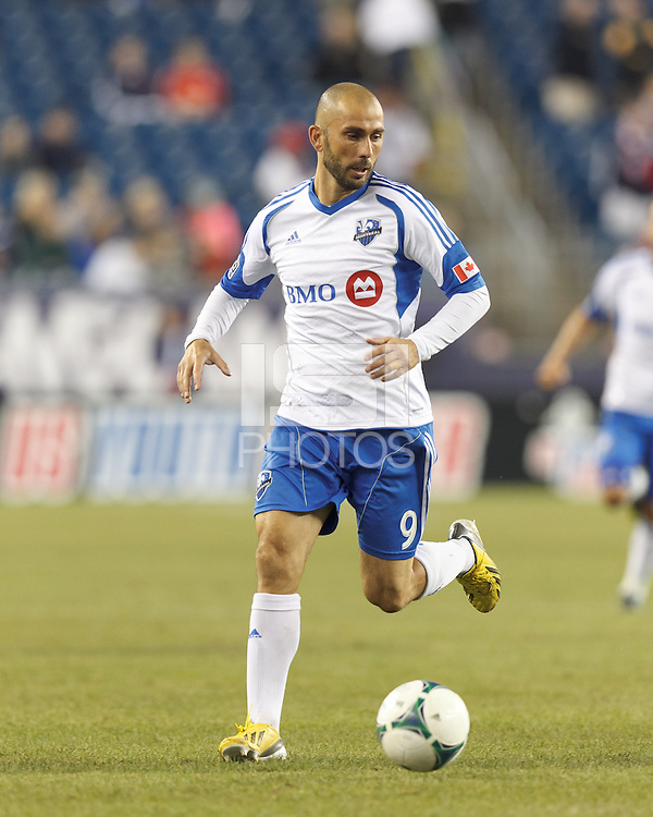 Montreal Impact forward Marco Di Vaio (9)  dribbles. In a Major League Soccer (MLS) match, Montreal Impact (white/blue) defeated the New England Revolution (dark blue), 4-2, at Gillette Stadium on September 8, 2013.