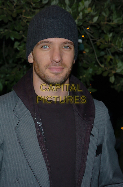 JC CHASEZ.Rock The Vote event at the Steven J. Ross Theater on the Warner Bros. Lot in Burbank, California.September 29, 2004.headshot, portrait, hat, stubble, facial hair, beard.www.capitalpictures.com.sales@capitalpictures.com.© Capital Pictures.