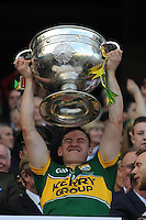 lifts the Sam Maguire Cup to celebrate  Kerry's victory over Donegal in the All-Ireland Football Final against  in Croke Park 2014.<br /> Photo: Don MacMonagle<br /> <br /> <br /> Photo: Don MacMonagle <br /> e: info@macmonagle.com