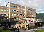 Modern architecture wooden apartment building on waterside in city centre, Tromso, Norway