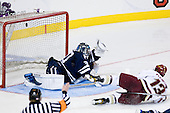 Cam Atkinson (BC - 13) completes his hat trick 4:16 into the third period scoring on Billy Blase (Yale - 30). - The Boston College Eagles defeated the Yale University Bulldogs 9-7 in the Northeast Regional final on Sunday, March 28, 2010, at the DCU Center in Worcester, Massachusetts.