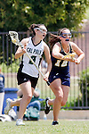 Los Angeles, CA 04/18/10 - Sarina Madnick (Cal Poly #9) and Rebecca Musser (UC Davis # 12) in action during the 2010 Western Women Lacrosse League Championship game between UC Davis and Cal Poly SLO for third place, hosted by UCLA.  UC Davis edged Cal Poly SLO 8-7 in overtime.