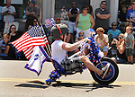 A boy riding his tricycle as part of the Rolling Thunder entry in the Saugerties July 4th Parade on Main Street in Saugerties, NY on Monday, July 4, 2011. Photo by Jim Peppler. Copyright © Jim Peppler 2011.