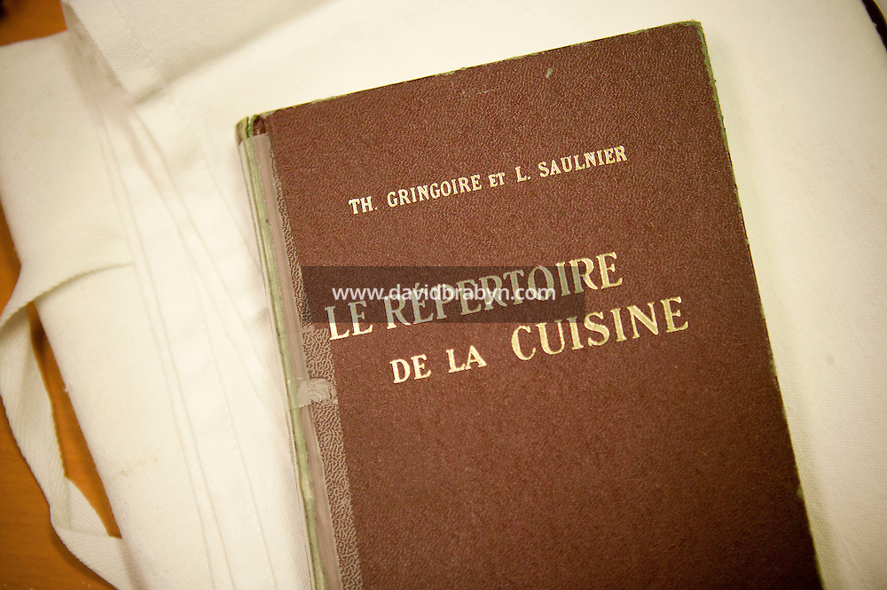 "Th. Gringoire and Louis Saulnier's book ""Le Repertoire de La Cuisine"" sits on a desk at the Ecole Superieure de Cuisine Francaise Gregoire Ferrandi cooking school in Paris, France, 19 December 2007."