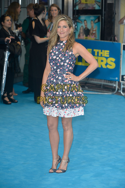 Jennifer Aniston<br /> 'We're the Millers' European UK film premiere, Empire cinema, Leicester Square, London, England.<br /> 14th August 2013<br /> full length blue pink white sleeveless floral print dress hand on hip<br /> CAP/PL<br /> &copy;Phil Loftus/Capital Pictures