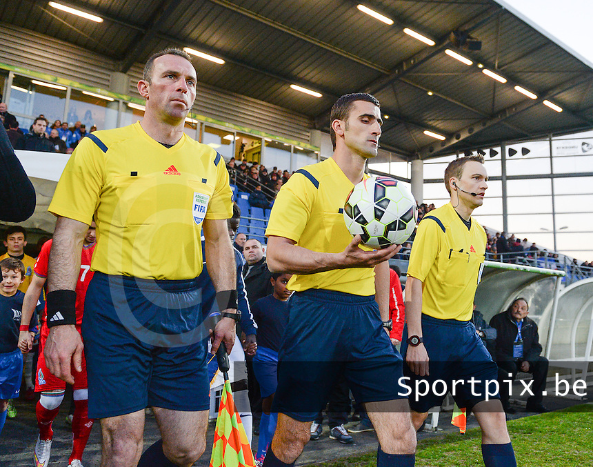 20150326 - SAINT-LO , FRANCE  : entrance on the pitch pictured from the referees with Djordjije Raznatovic (left) , Nikola Dabanovic (middle) and Vital Jobin (right)  during the soccer match between Under 19 teams of France and Azerbaijan , on the first matchday in group 7 of the UEFA Elite Round Under 19 at stade Louis Villemer , Saint-Lo France . Thursday 26 rd  March 2015 . PHOTO DAVID CATRY