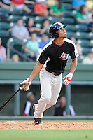 Outfielder Nick Williams (1) of the Hickory Crawdads bats in a game against the Greenville Drive on Friday, June 7, 2013, at Fluor Field at the West End in Greenville, South Carolina. Williams is the No. 25 prospect of the Texas Rangers, according to Baseball America and was a second-round pick in the 2012 First-Year Player Draft. Greenville won the resumption of this May 22 suspended game, 17-8. (Tom Priddy/Four Seam Images)