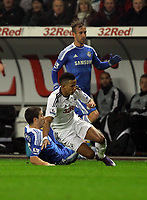 Pictured: Scott Sinclair of Swansea (C) brought down by Oriol Romeu (L) of Chelsea. Tuesday, 31 January 2012<br />