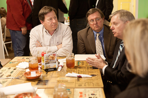 March 26, 2013. West Columbia, South Carolina . Sen. Lindsey Graham stopped by Mrs. B's Southern Kitchen to greet diners and discuss his plans for the political season with his base. He talked about the economy with Andy White, left, and Earl McLeod.. Sen. Lindsey Graham, R- South Carolina, is up for reelection in 2014. He spent some time talking to his base back home about issues such as immigration reform as he readies himself for his campaign run..