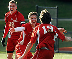 Somers 3, Tim O'Hearn, center, couldn't pick a better time to score his first goal of the season as celebrates  with  teammates 19, Ben Hurchala, and 16, Justin Brewer, O'Hearn, who  is  a senior, plays sparingly as a sub had just come into the game Sunday afternoon, November 16, 2008, in Waterbury, Somers and Old Lyme were tied 2-2 after double overtime and will share the Class S state title.