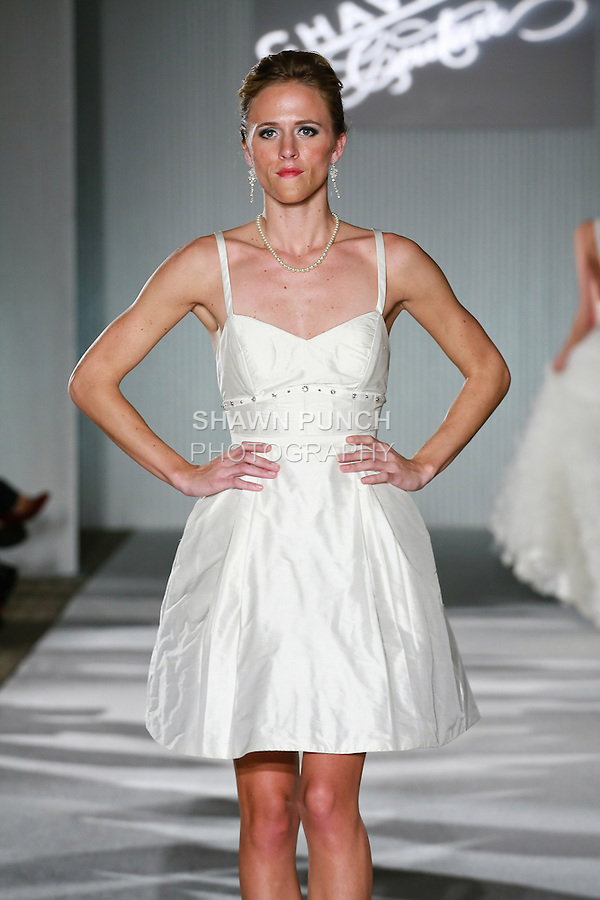 Model walks the runway in a Chaviano Couture Ruby Marie wedding dress by Annette Thurmon, during the Wedding Trendspot Spring 2011 Press Fashion show, October 17, 2010.