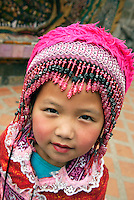 "Don't be fooled by this Hmong tribal cutie I encountered at the base of Wat Prathat Doi Suthep in Chiang Mai, Thailand...she was working. A moment after snapping this shot, her hand went out. I said ""no money."" She said, in her practiced English and with scowl now on her adorable face, ""no money...no picture."" It is not an unfamiliar tactic, but I don't condone the practice with my money. When young children become family wage earners, they rarely go to school and are destined to a life of poverty."