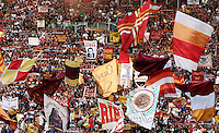Calcio, Serie A: Roma vs Bologna. Roma, stadio Olimpico, 16 settembre 2012..AS Roma fans wave flags during the Italian Serie A football match between AS Roma and Bologna at Rome's Olympic stadium, 16 september 2012..UPDATE IMAGES PRESS/Riccardo De Luca