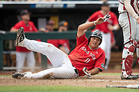 Texas Tech Red Raiders first baseman Cameron Warren (11) slides into home with the winning run during Game 5 of the NCAA College World Series against the Arkansas Razorbacks on June 17, 2019 at TD Ameritrade Park in Omaha, Nebraska. Texas Tech defeated Arkansas 5-4. (Andrew Woolley/Four Seam Images)