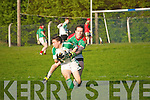 Ballydonoghue's David O'Connor gets wins  the ball from Beale's John Griffin.
