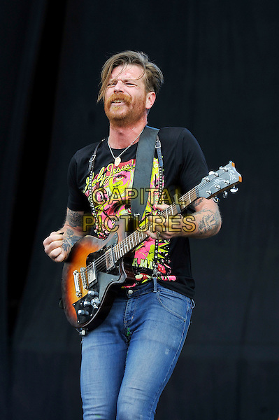 Jesse Hughes of Eagles of Death Metal.performing on Day 3 at Reading Festival, Reading, England. .26th August 2012.on stage in concert live gig performance performing music half jeans denim length black t-shirt beard facial hair guitar  3/4 tattoos.CAP/MAR.© Martin Harris/Capital Pictures.
