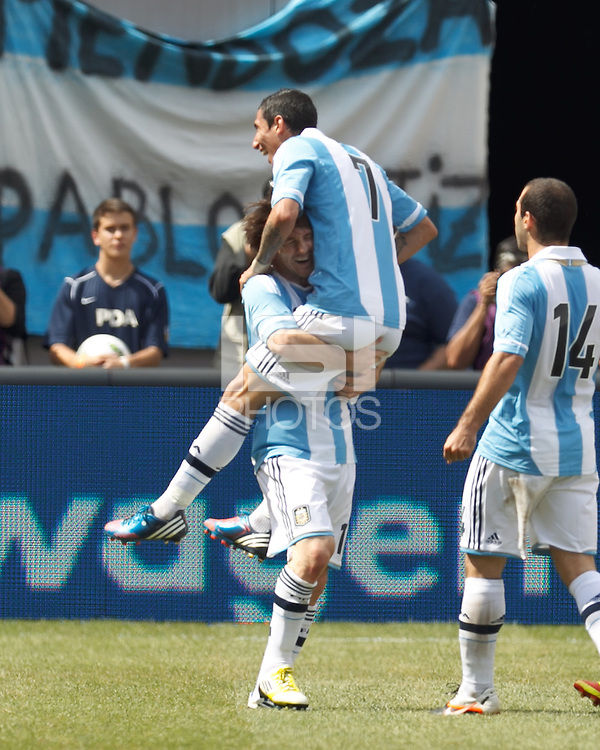 Argentina forward  Lionel Messi (10) celebrates second of his three goal effort with teammates. In an international friendly (Clash of Titans), Argentina defeated Brazil, 4-3, at MetLife Stadium on June 9, 2012.