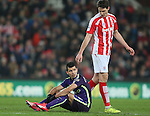 Sergio Aguero of Manchester City sits injured waiting to leave the field - Barclays Premier League - Stoke City vs Manchester City - Britannia Stadium - Stoke on Trent - England - 11th February 2015 - Picture Simon Bellis/Sportimage