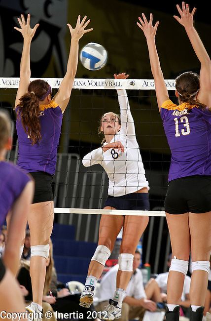 SIOUX FALLS, SD - OCTOBER 26:  Kayla Wallerich #8 from Augustana tries for a kill between Kayla Berning #11 and Jill Storlie #13 from Minnesota State University Mankato in the second game of their match Friday night at the Elmen Center. (Photo by Dave Eggen/Inertia)