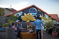 October 31, 2011 - Phnom Penh, Cambodia. People have sunset drinks and take pictures at a popular roof top bar on the riverside. © Nicolas Axelrod / Ruom