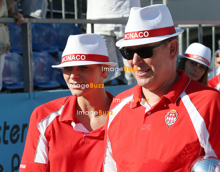Prince Albert II of Monaco and Princess Charlene attend the 2013 Masters petanque tournament in Monaco. September 5, 2013.