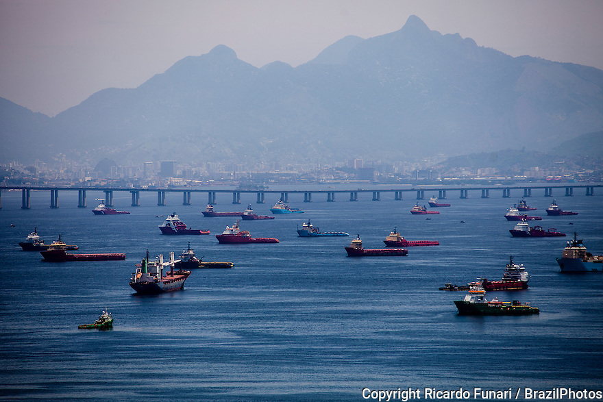 Heavy vessel and ship traffic inside Guanabara Bay, Rio-Niteroi bridge in background.