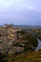 View of city from east of Tajo river. Large building at top of hill is El Alcazar. Toledo Castilla-La Mancha Spain.
