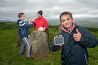 xxjob: Conor Power and his son Mark (13) and friend Finnian O'Donovan (13) find the buried 'treasure' using geo caching outside Kealkill in West Cork.<br /> Picture by Don MacMonagle