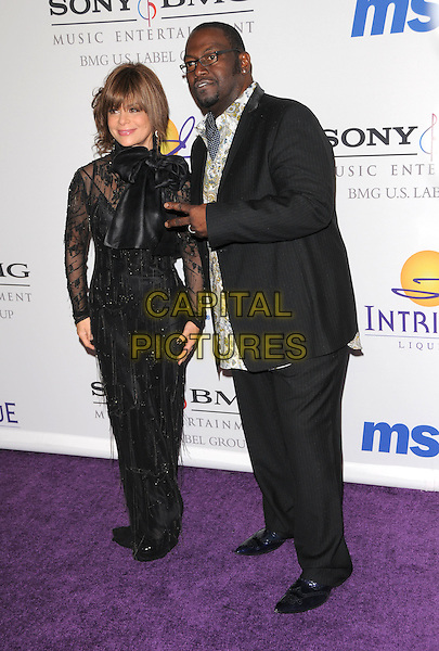 PAULA ABDUL & RANDY JACKSON.The 2008 Clive Davis Pre-Grammy Party held at The Beverly Hilton Hotel in Beverly Hills, California, USA..February 9th, 2008     .full length black sheer dress brown suit hand v peace sign glasses .CAP/DVS.©Debbie VanStory/Capital Pictures