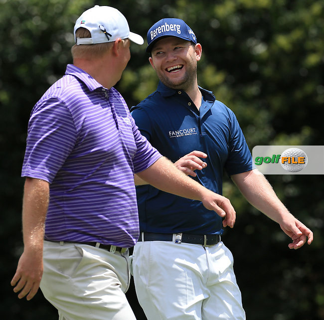 Branden Grace (RSA) enjoying the craic with Ross McGowan (ENG) during Round Three of the 2016 BMW SA Open hosted by City of Ekurhuleni, played at the Glendower Golf Club, Gauteng, Johannesburg, South Africa.  09/01/2016. Picture: Golffile | David Lloyd<br /> <br /> All photos usage must carry mandatory copyright credit (&copy; Golffile | David Lloyd)