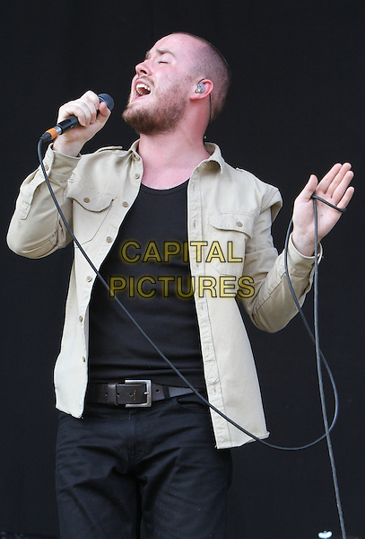 Michael Stafford, better known as Maverick Sabre.V Festival 2012 - Day One, Hylands Park, Chelmsford, Essex, England..August 18th 2012.on stage in concert live gig performance music half length black top beige jacket singing beard facial hair profile .CAP/JIL.©Jill Mayhew/Capital Pictures