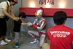"""July 27 2012, Tokyo, Japan - A child greets Ultraman at """"Ultraman Festival 2012"""" in Tokyo. To celebrate the 45th anniversary of the hero, fans can enjoy the Festival from 27 July to 2 September at Sunshine City complex in Ikebukuro, Tokyo. (Photo by Rodrigo Reyes Marin/AFLO)"""