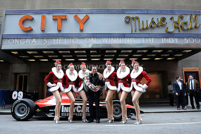 WWW.ACEPIXS.COM . . . . . ....May 26 2009, New York City....Racing driver Helio Castroneves celebrated his Sunday May 24 2009 Indy 500 win outside the iconic Radio City Musical Hall with six 'Rockettes' dancers. Castroneves, who has won the race three times, wore his winner's weath and carried a bottle of milk on May 26 2009 in New York City.....Please byline: KRISTIN CALLAHAN - ACEPIXS.COM.. . . . . . ..Ace Pictures, Inc:  ..tel: (212) 243 8787 or (646) 769 0430..e-mail: info@acepixs.com..web: http://www.acepixs.com