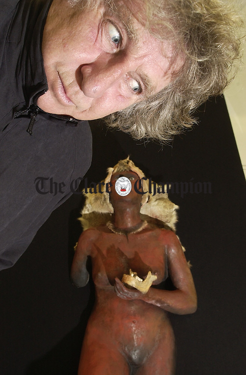 """Artist Keith Payne with """"Poulabrucky"""" , just one of his pieces from  his latest exhibition, Cave Two, which runs at Glor as part of the October Arts festival until October 28th. Photograph by John Kelly."""
