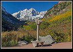 Try to give the viewer a sense of being there. Who can't imagine standing here?<br /> Telescope pointed to the Maroon Bells in autumn, near Aspen. John offers private, photo tours of Colorado's mountains - all year.