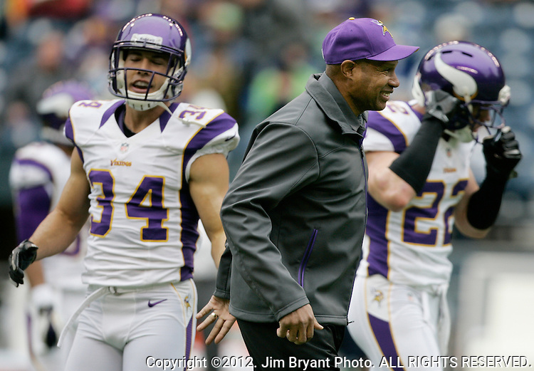 Minnesota Vikings Head Coach Leslie Frazier ,center, jokes with Andrew Sendejo (34) and Harrison Smith (22)  before their game against the Seattle Seahawks at CenturyLink Field in Seattle, Washington on  November 4, 2012.     ©2012. Jim Bryant Photo. All Rights Reserved.