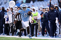 CHAPEL HILL, NC - NOVEMBER 23: Michael Carter #8 of the University of North Carolina rushes 45 yards for a touchdown during a game between Mercer University and University of North Carolina at Kenan Memorial Stadium on November 23, 2019 in Chapel Hill, North Carolina.