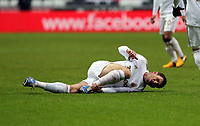 Saturday 19 January 2013<br /> Pictured: Angel Rangel of Swansea injured on the ground<br /> Re: Barclay's Premier League, Swansea City FC v Stoke City at the Liberty Stadium, south Wales.
