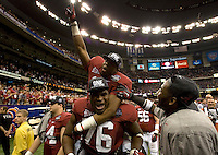 Alabama players' Alex Watkins and D.J. Fluker celebrates after winning BCS National Championship game at Mercedes-Benz Superdome in New Orleans, Louisiana on January 9th, 2012.   Alabama defeated LSU, 21-0.