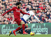 9th February 2019, Anfield, Liverpool, England; EPL Premier League football, Liverpool versus AFC Bournemouth; Mohamed Salah of Liverpool brings down Diego Rico of Bournemouth
