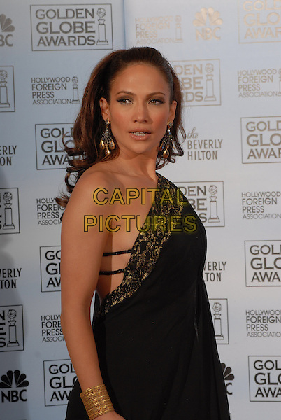 "JENNIFER LOPEZ.Pressroom - 64th Annual Golden Globe Awards, Beverly Hills HIlton, Beverly Hills, California, USA..January 15th 2007. .globes press room Marchesa half one shoulder gold pattern black earrings dress straps bracelet.CAP/AW.Please use accompanying story.Supplied by Capital Pictures.© HFPA"" and ""64th Golden Globe Awards"""