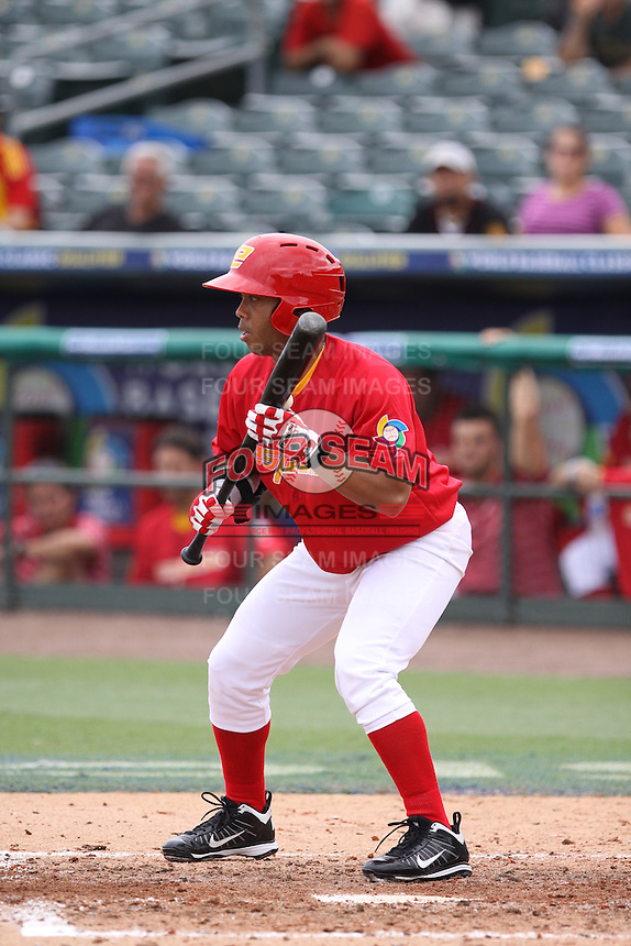 Yasser Gomez of Team Spain at bat during a game against Team Israel during the World Baseball Classic preliminary round at Roger Dean Stadium on September 21, 2012 in Jupiter, Florida. Team Israel defeated Team Spain 4-2. (Stacy Jo Grant/Four Seam Images)